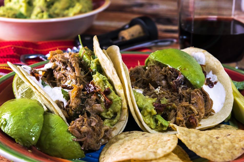 Garnish these Instant Pot Pork Tacos with guacamole and sour cream.